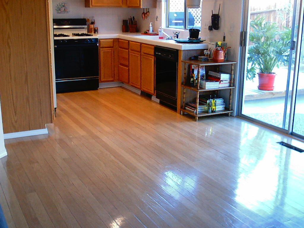 Laminate flooring pergo laminate flooring in kitchen for Kitchen laminate flooring